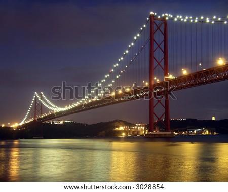 Bridge over Tagus river in Lisbon, Portugal - stock photo