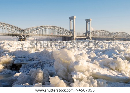 Bridge over the frozen river Neva in sunny day - stock photo