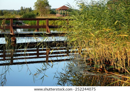 Bridge over the lake - stock photo