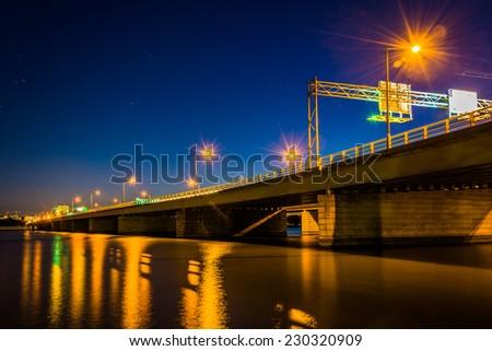 Bridge over the Potomac River at night in Washington, DC. - stock photo