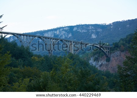 bridge over the river in the mountains of Montenegro - stock photo