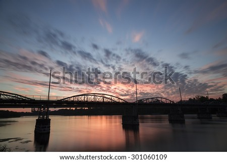 Bridge over the Umea, River in Sweden at Sunset