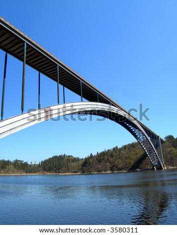 Bridge over the Vltava river. Massive steel construction with a long arch. - stock photo