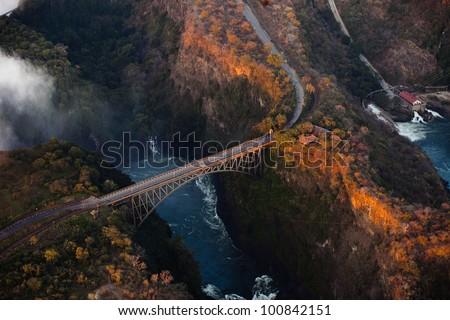 Bridge over the Zambezi River Gorge at Victoria Falls from the air - stock photo