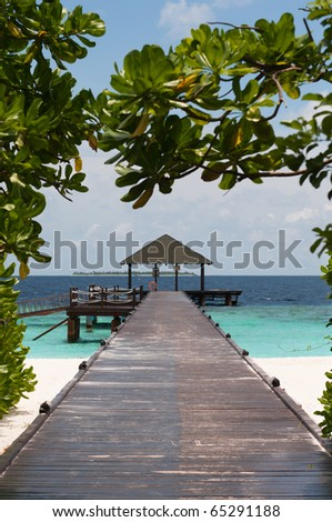 bridge over turquoise ocean - stock photo