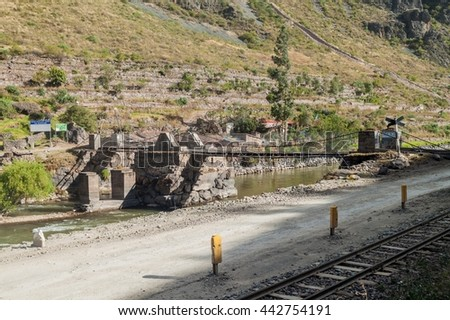Bridge over Urubamba river in Ollantaytambo village, Sacred Valley of Incas, Peru - stock photo