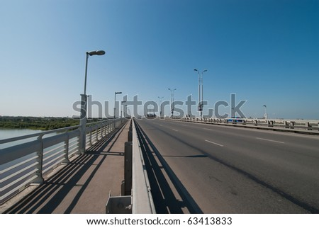 bridge over water with laterns on the sky background