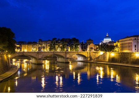 Bridge Ponte Vittorio Emanuele II and St. Peter's cathedral in Rome, Italy. - stock photo
