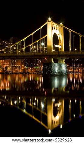 Bridge reflection in water - stock photo