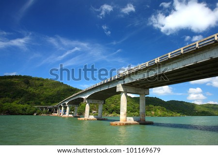 Bridge Road on the sea, blue sky background - stock photo