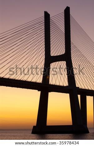 Bridge sunrise Tagus river - stock photo