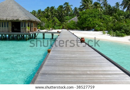 bridge to tropical island - stock photo