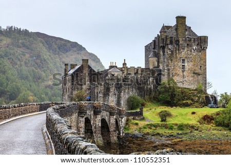 Bridge towards Eilan Donan castle in Scotland on a grey day