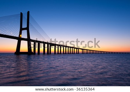 Bridge Vasco da Gama sunrise Lisbon Portugal - stock photo