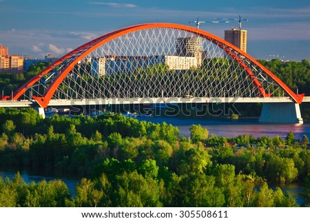 bridge with red arch on sunset background - stock photo