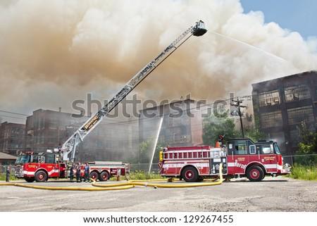 BRIDGEPORT, CT , U.S. - AUGUST 4:  The Bridgeport Fire Department battles a blaze in the vacant Remington Arms Factory in Bridgeport, Ct. on August 4, 2012. - stock photo