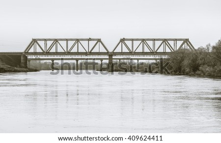 Bridges over river Ugra. Kaluga region, Russia. Black-and-white in light tinting - stock photo