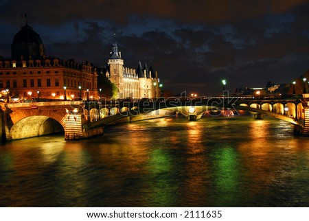 Bridges over Seine and Conciege in nighttime Paris France