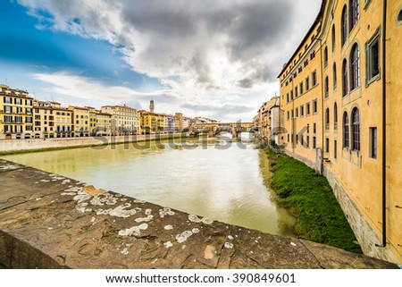 bridges over the Arno river which runs through the historic buildings of Florence in Tuscany
