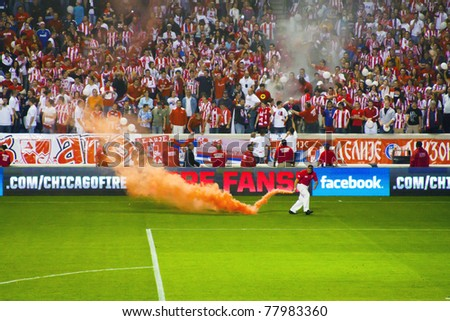BRIDGEVIEW - MAY 19: Serbian Red Star Belgrade fans in the stadium during the match Between Red Star Belgrade and Legia Warsaw on May 19, 2010 in Bridgeview, USA - stock photo