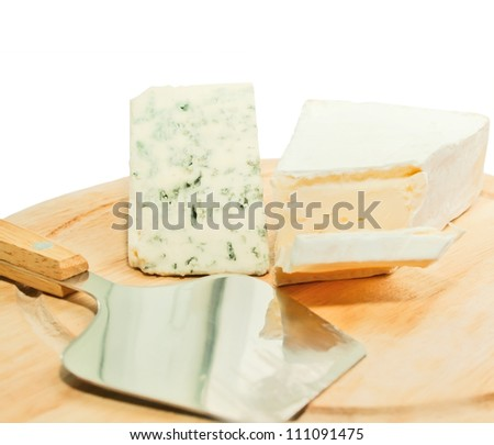 Brie and dor blue cheese on wooden desk with knife isolated