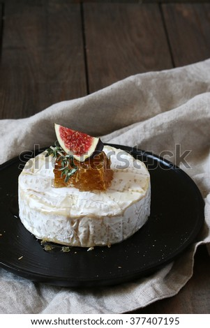 brie cheese with honey and figs - stock photo
