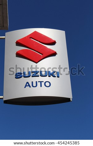 BRIE COMTE ROBERT, FRANCE - JULY 17, 2016: Suzuki sign in Brie Comte Robert, France. Suzuki Motor Corporation is a Japanese manufacturer of motorcycles, automobiles and marine engines.