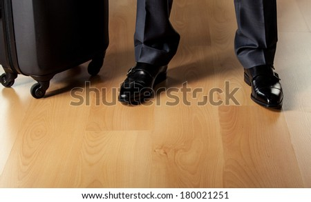 Briefcase and businessman's legs - closeup shot
