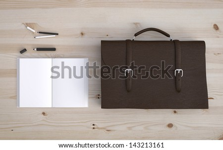 briefcase and notebook and some office supplies on wooden background