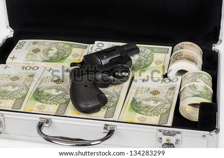 briefcase filled with money, guns - stock photo