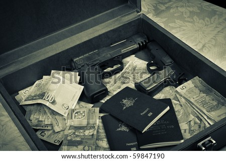 briefcase filled with money, guns and passport - stock photo