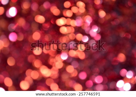 Bright and abstract blurred purple background with shimmering glitter - stock photo