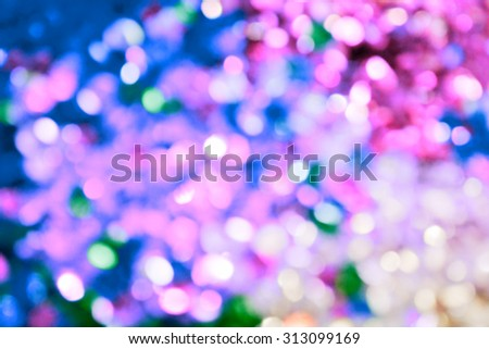 Bright and abstract blurred sea blue and violet background with shimmering glitter - stock photo