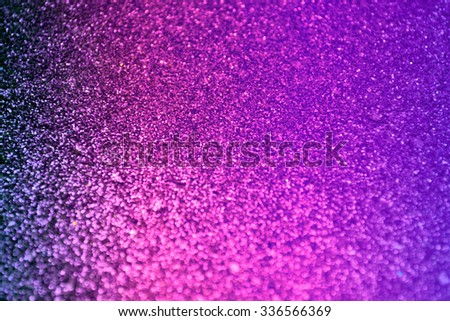 Bright and abstract blurred sea blue, red and violet background with shimmering glitter - stock photo