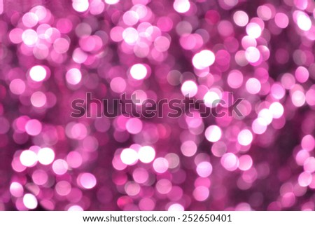 Bright and abstract blurred violet background with shimmering glitter - stock photo