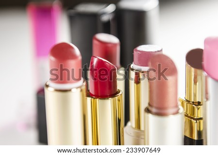 bright and beautiful lipsticks with lip tassel isolated on white background. - stock photo