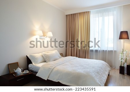 bright and brand new interior of european bedroom - stock photo