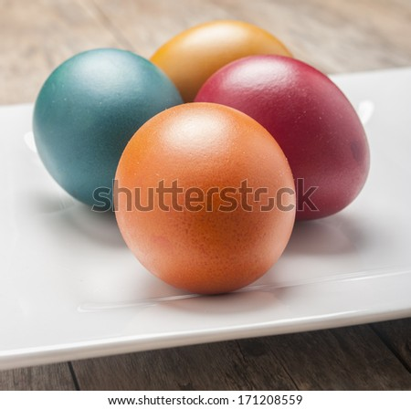 Bright and cheerful Easter still life with rainbow color eggs  - stock photo
