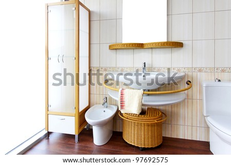 Bright and clean bathroom interior with rattan fixtures - stock photo