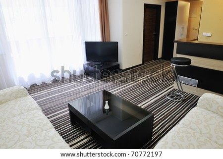 bright and clean hotel room interior with modern furniture - stock photo