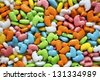 Bright and colorful duck shaped candies in a gumball dispenser. - stock photo
