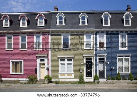 Bright and colorful yet typical unique old housing style in the old part of downtown St. John's, Newfoundland, Canada. - stock photo