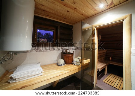 bright and hot interior of modern russian sauna