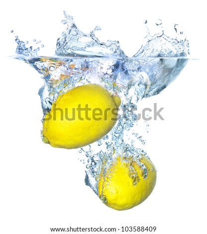 Bright and juicy lemon under water. Fresh and healthy meal - stock photo