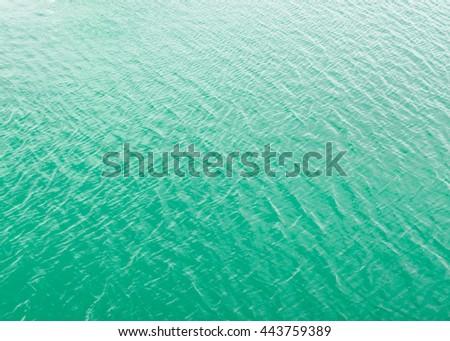 Bright and vivid green see water texture - stock photo