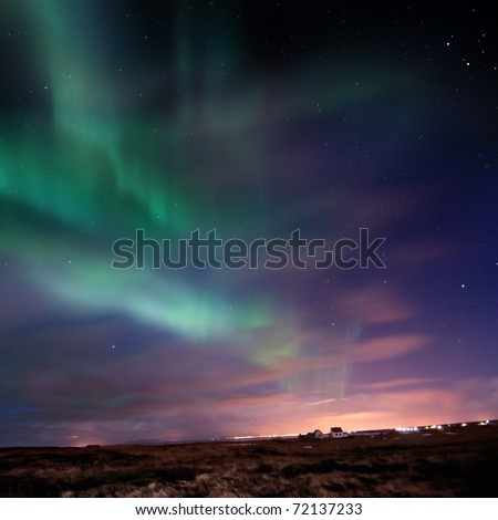 Bright Aurora Borealis (Northern Lights) over southern Iceland, Febuary 2011.  grainy image - stock photo