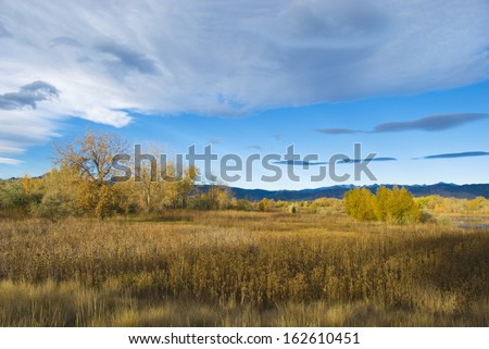 Bright autumn scene in the early morning in a wetlands refuge area on the Colorado prairie - stock photo