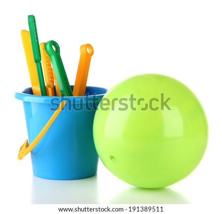 Bright ball and sandbox toys isolated on white - stock photo
