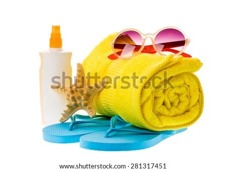 Bright beach accessories isolated on white: flip-flops, sunscreen, sunglasses, towel, starfish - stock photo
