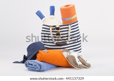 Bright beach summer accessories isolated on white background - stock photo